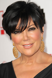 Kris Jenner balanced her short raven locks with dangling earrings that demanded attention.