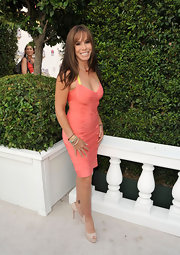 Arriving at the Comedy Central Roast of Joan Rivers, Melissa cut a slim sexy figure in this bright coral bandage dress.