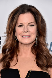Marcia Gay Harden sported a loose, curly hairstyle when she attended the Comedy Central Roast of Rob Lowe.