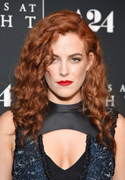 Riley Keough punched up her beauty look with a swipe of bright red lipstick.