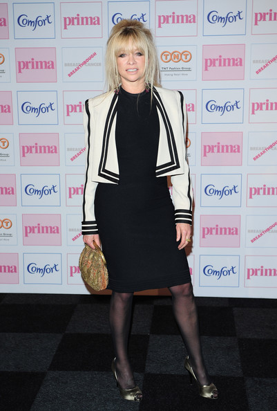 Jo looked chic in her directional monochrome cropped jacket at the Comfort Prima High Street Fashion Awards in London.