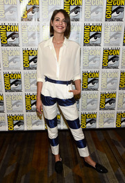 Willa Holland spruced up her plain top with a pair of blue and white striped pants.