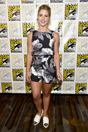 Emily Bett Rickards opted for white flatform slip-ons with metal toecaps to complete her breezy outfit.