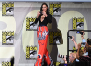 Gal Gadot teamed a pair of printed palazzo pants with a black bodysuit, both by Solace London, for Comic-Con International 2016.