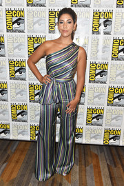 Stephanie Beatriz worked a candy cane-striped one-shoulder jumpsuit at the Comic-Con International 2018 'Brooklyn Nine-Nine' press line.