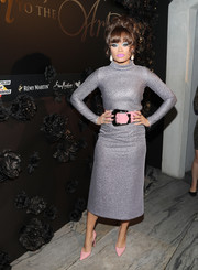 Andra Day punctuated her silver look with pink pumps and a matching belt.