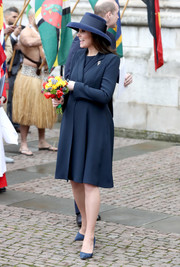 Kate Middleton kept it simple and classic in a navy coat by Beulah London at the Commonwealth Day service and reception.