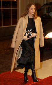 Stella McCartney arrived for the Commonwealth Fashion Exchange Reception wearing a beige wool coat over a black dress.