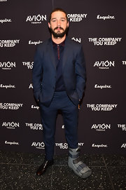 Shia LaBeouf opted for a more modern look when he chose this two-button, notch-lapel navy suit paired over a matching polo.