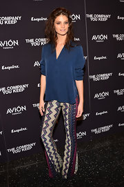 Charlbi Dean Kriek opted for a more bohemian-inspired evening look when she chose this navy blouse and printed pants.