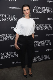Rachel Weisz was all about no-frills sophistication at the New York premiere of 'Complete Unknown' in a white Monse top with short, cuffed sleeves and gold button detail.