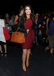 Kimberly Guilfoyle perfected an already chic ensemble with a tan Birkin.
