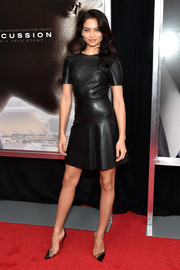 Shanina Shaik rocked a black leather skater dress at the New York premiere of 'Concussion.'