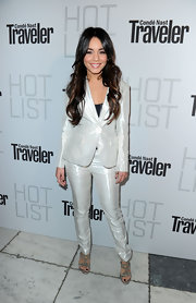 Vanessa shines at the Hot List party in a sleek white iridescent pant suit with sparkling evening sandals.