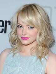 Emma Stone exuded spring fever at the Conde Nast Traveler Hot List Party with platinum blond curls and hot pink lipstick.