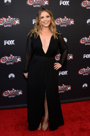 Kether Donohue put on a daring display in a plunging black gown at the 'Grease: Live' FYC event.