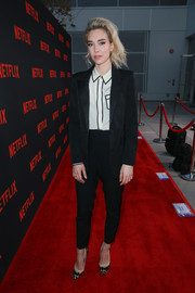 Vanessa Kirby teamed a black suit with a monochrome button-down for the 'Crown' FYC event.