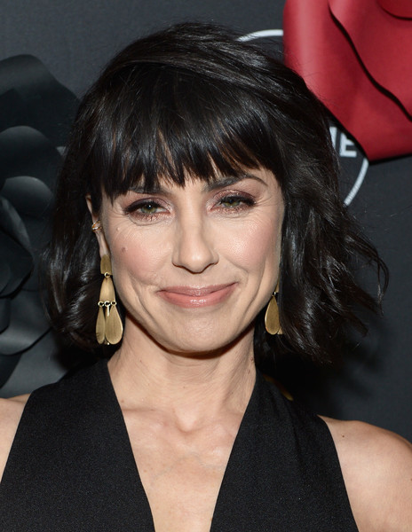 Constance Zimmer Gold Chandelier Earrings [unreal,hair,face,hairstyle,eyebrow,bangs,chin,lip,black hair,cheek,layered hair,constance zimmer,mary kills people,lifetime hosts anti-valentines,premieres,eveleigh,west hollywood,california,lifetime,anti-valentines bash]