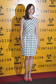 Marion paired her chic checkered dress with coral platform pumps complete with chain link detailing.