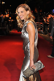 Hilary showed off a old metallic clutch while hitting the red carpet.
