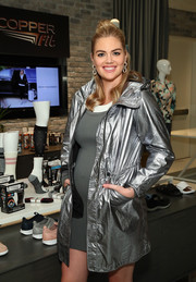 Kate Upton looked cute in a silver raincoat at the Copper Fit launch event.
