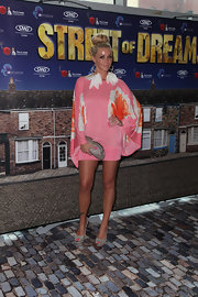 Holly was daring in a hot pink '70s-inspired kimono dress.