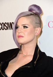 You can always rely on Kelly Osbourne to spice up any event with her many hair incarnations. For Cosmopolitan's 50th birthday celebration, she chose this cute and funky side-shaved top bun (in her signature lavender, of course).