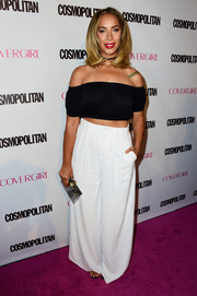 Leona Lewis chose a pair of baggy white pants to complete her look.
