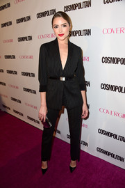 Olivia Culpo suited up in this stylish black pinstripe number for Cosmopolitan's 50th birthday celebration.