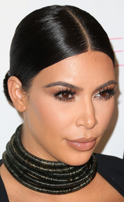 Kim Kardashian slicked her hair down into a severe center-parted bun for Cosmopolitan's 50th birthday celebration.