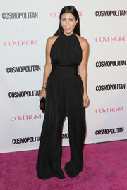 Kourtney Kardashian cut a shapely silhouette in her black Balmain jumpsuit during Cosmopolitan's 50th birthday celebration.