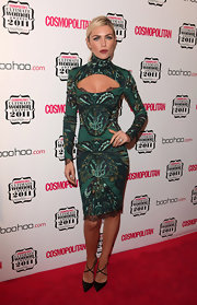 Abbey Clancy wore a green abstract print dress with a yoke cutout for the Cosmopolitan Women of the Year Awards.