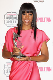 Kelly Rowland wore splashes of metallic nail polish with a glitter top coat at the 2011 'Cosmopolitan' Ultimate Women of the Year Awards. She used super shiny shades of gray, silver, bronze and gold and then swept on a top coat containing bits of clear glitter. To recreate her look, add dabs of your favorite shades of metallic polish and then brush on a coat of Nails Inc. Special Effects Electric Lane Holographic Glitter Top Coat.