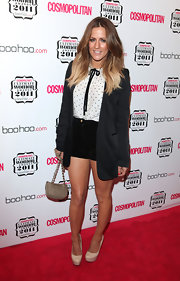 Caroline Flack donned a whimsical outfit on the red carpet at the 'Cosmopolitan' event in London. She accessorized her look with ivory platform pumps.