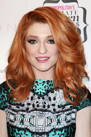 Nicola Roberts added some volume to her look with layered curls.