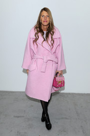 Anna dello Russo bundled up in a sweet-hued Carven wool coat for the Costume National Homme fashion show.