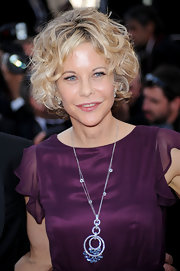 "Meg Ryan attended the ""Countdown To Zero"" premiere while in Cannes. She showed off her signature curly bob, while strutting her stuff on the red carpet."