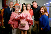 Kacey Musgraves paired her cute frock with a multicolored box clutch by Edie Parker.