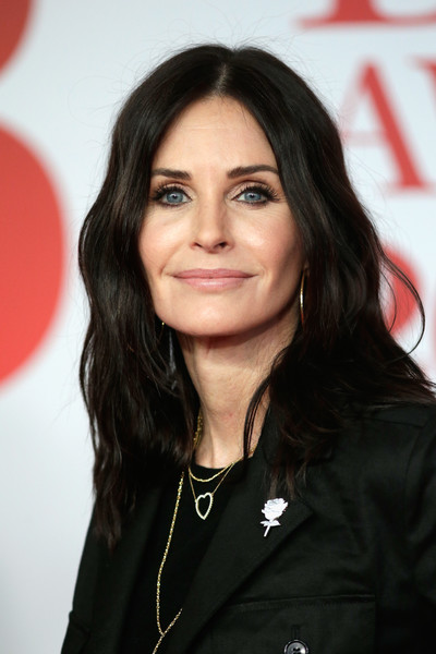 Courteney Cox Medium Wavy Cut [beauty,hairstyle,eyebrow,fashion model,long hair,black hair,smile,brown hair,premiere,layered hair,red carpet arrivals,courteney cox,brit awards,relation,the o2 arena,england,london]