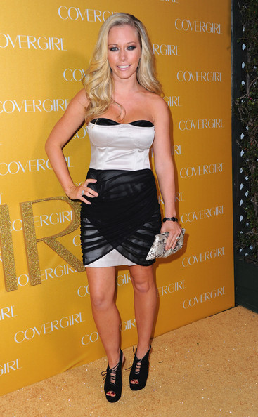 Kendra Wilkinson toughened up her sultry cocktail dress with black platform cutout boots.
