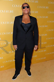 Queen Latifah wore a pant suit over a corset top. She paired the sexy look with aviators and sneakers.