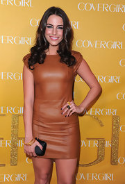 Actress Jessica Lowndes paired her tan leather dress with 14-karat yellow gold spiral bangles.