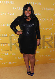 Amber Riley was a glamazon in purple platforms embellished with glittery black bows.