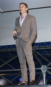 Daniel Craig spoke at the Festical del Film di Locarno in a slim-fit beige pinstripe suit.