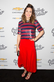 Mandy Moore coordinated her outfit with a pair of red Tamara Mellon Frontline sandals.