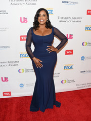 Niecy Nash flaunted her fabulous curves in a navy Chiara Boni La Petite Robe gown with sheer sleeves at the 2018 Television Industry Advocacy Awards.