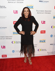 Patricia Heaton styled her LBD with strappy gold heels.