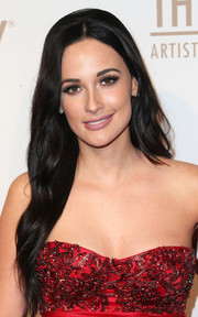Kacey Musgraves wore long, barely-there waves when she attended the Creators party.