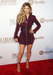 Fergie chose a military-inspired burgundy zip-up mini dress for the Creators party.