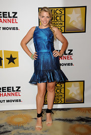 Busy Philipps paired her metallic blue frock with unique nude sandals with black ankle wraps and chunky stacked wooden heels.